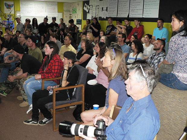 A packed classroom watched SAEL students present their performance art, slide show, poetry, film, and dance.