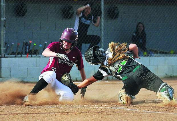 Bear River High School senior and team captain Kaitlyn Maddux, slides safely into home plate before the tag of Colfax catcher Sophie Smith during the Bruins PVL league opening win Wednesday at Bear River. The Bruins won 9-4.