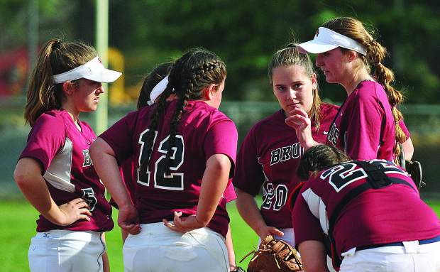 Bear River pitcher and team captain Kaitlyn Maddux, talks to her infield during the fourth inning of Wednesday's come from behind win over the Colfax Falcons.
