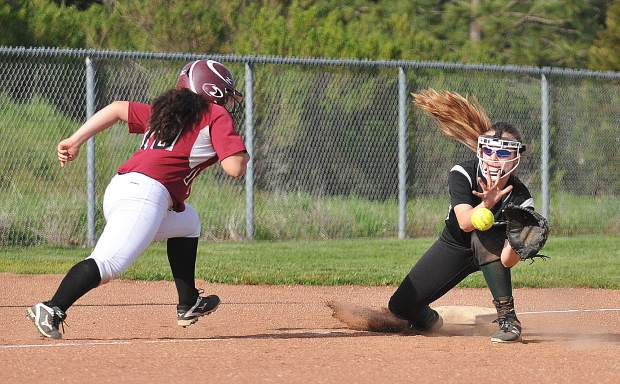 Bear River outfielder Massiel Chavez, is caught leading off third base too far and is tagged out by the Colfax third baseman.