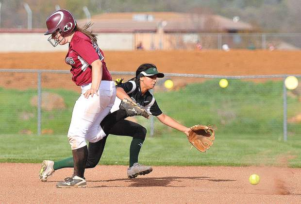 Bear River senior Gabi Royston runs past Colfax shortstop Rylee Bautista during a Bear River hit Wednesday. Royston would end up scoring to help with the Bruins' 9-4 win over the visiting Colfax Falcons.