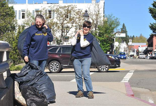 Robin Milan, and Kathy Wilcox-Barnes of the Nevada City Rotary Club, ready to haul off their trash pulled from the Miners Trail. The group periodically cleans trash from the trail and say what they picked up was from within the past week.