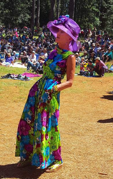 Chris Hemy, of Yuma, Arizona, dances during the Sunday Revival. Hemy works seasonally as an ICU nurse and then spends the summer volunteering at music festivals.