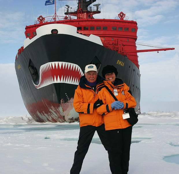 Ed and Bernadette Sylvester stopped during their 2005 trip to the North Pole to have this photo taken with a Russian Nuclear-powered Icebreaker in the background.