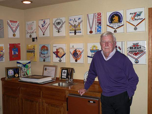 One wall of the Sylvester home is adorned with the 23 medal and t-shirts Ed Sylvester earned by completing as many marathons. He was the 14th person in the world to complete marathons on every continent including Antarctica.
