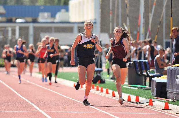 Nevada Union junior Kelly Gough kicks in the last stretch of the 800 meter race during Saturday's track meet at Nevada Union High School. Though Gough led most of the race, she was surpassed at the last second by a Buckingham runner.