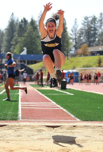 Nevada Union senior Danica Minard flys through the air to mark her furthest jump at 15 feet during the Nevada Union and Bear River Invitational Track Meet Friday at Nevada Union High School.