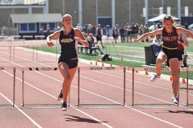Nevada Union's Greta Kramer clears the last hurdle and heads for the finish line to bring in a first place in the 800 meter hurdles.