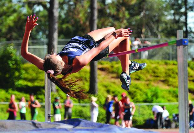 Forest Lake Christian high jumper Lily Sween makes the jump at 5'3