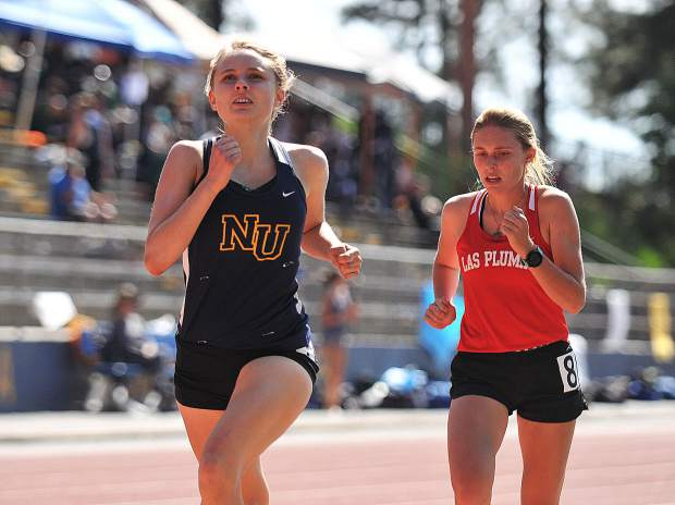 Nevada Union senior Anya Cooper-Hynell concentrates on the finish line before bringing in first place during the 3,200 meter race at the Kays Ostrom Nevada Union/Bear River Invitational.