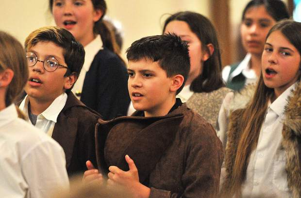 Grass Valley Charter School's Gibson Cain (center) sings an original Greg Wolfe song during Wednesday evening's Boston Tea Party debate re-enactment at Emmanuel Episcopal Church in Grass Valley.