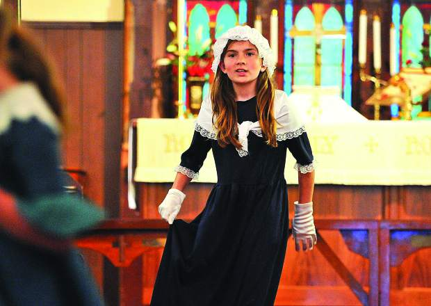 Grass Valley Charter School fifth grader Abigail Ricketts, recites her role as a Bostonian in 1773 colonial America during the school's bi-annual celebration of the Boston Tea Party Debate Wednesday evening at Emmanuel Episcopal Church in Grass Valley. The Grass Valley church, built in 1855, was a fitting backdrop for the debate which originally took place at the Old South Meeting House in Boston Massachusetts.