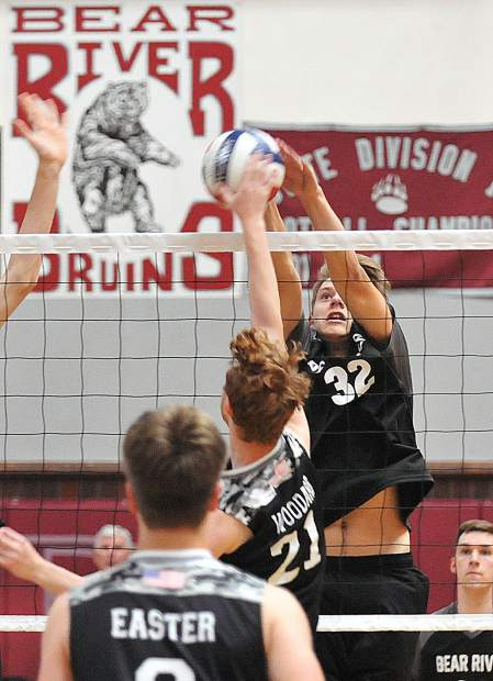 Bear River's Jace Rath makes a block for a point during Tuesday's win in three straight sets over Lincoln High School.