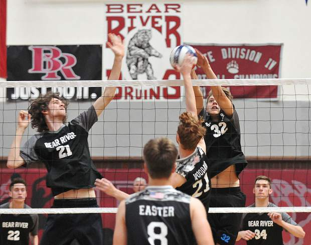 Bear River's Trevor Chandler (21) and Jace Rath (32) go up for a block during Tuesday's win over Lincoln High School. Chandler is just one of two seniors on the team. Rath is one of four freshman on the squad.