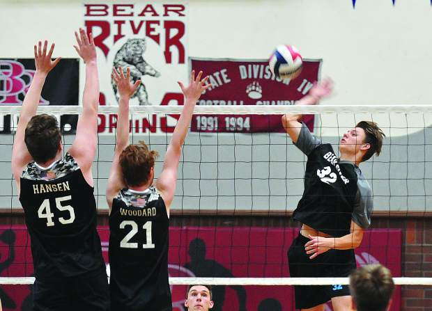 Bear River's Jace Rath hits a spike over his Lincoln High School opponents during Tuesday's victory in three straight sets.