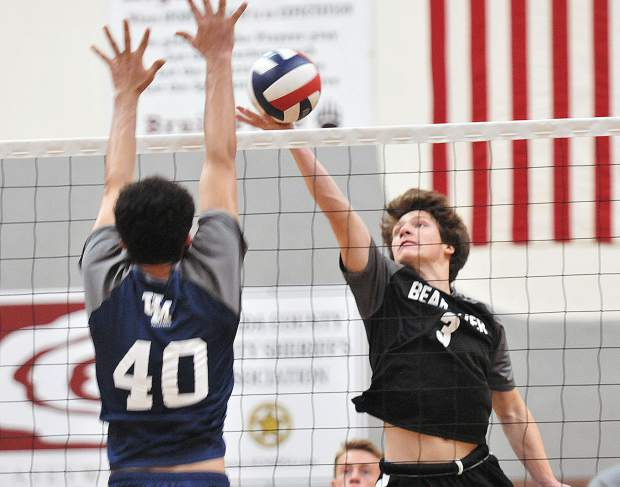Bear River sophomore Brekyn Vasquez lobs the volleyball over the net during the second of five sets played against the Union Mine Diamondbacks.