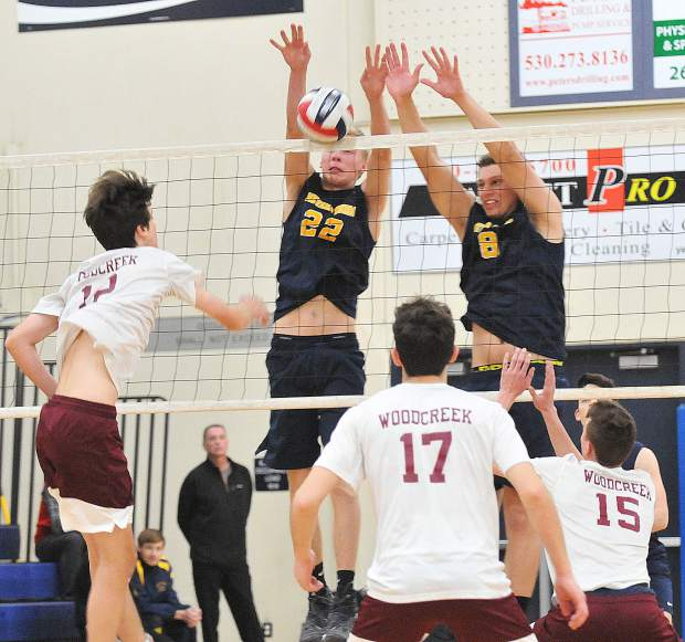 The Union's Tanner Quiggle (22) and Ibrahim Torkman (8) score a point while making a block against Woodcreek Wednesday night at Nevada Union High School.