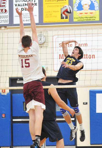 Nevada Union High School junior Jordan Mills readies to spike the ball over the net during the Miners' league win over the Woodcreek Timberwolves at the Albert Ali Gymnasium earlier this season. Mills is one of five Miners with more than 100 kills this season.