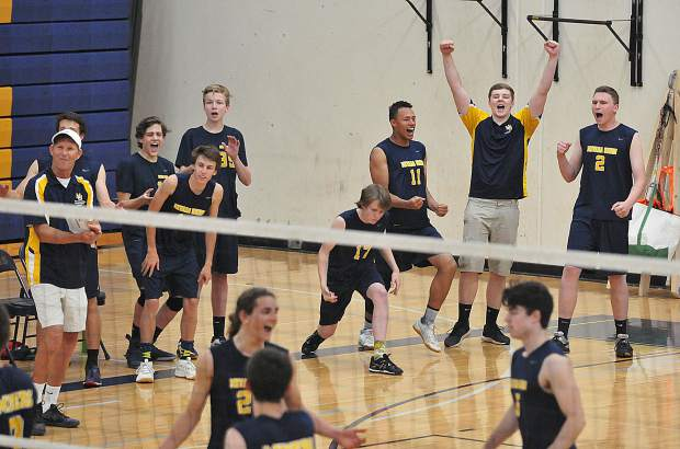 The Nevada Union varsity boys volleyball team reacts after scoring one of their final points in a four set match playoff win against the visiting Davis Blue Devils.