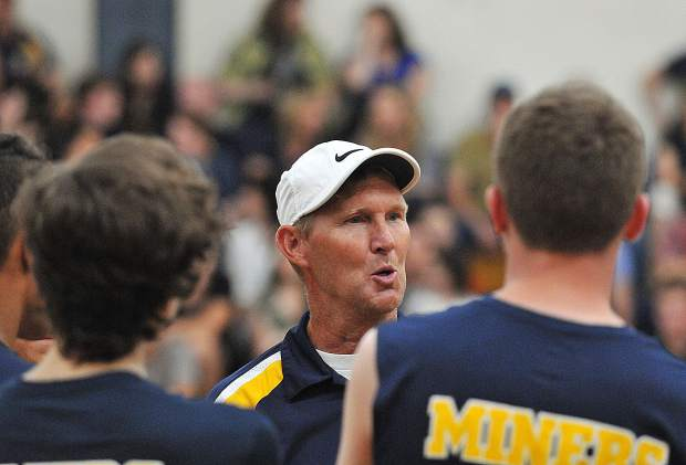 Nevada Union varsity boys volleyball head coach Lance Mansuetti talks over a few pointers with the team during a time out.