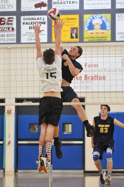 Nevada Union High School senior Ibrahim Torkman, slams a spike over the net during the Miners second round playoff win over the Ponderosa Bruins in three straight sets.
