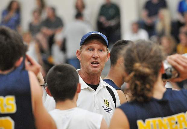 Nevada Union varsity boys volleyball head coach Lance Mansuetti keeps the intensity of his team up while the team readies to play their third set for the win over Ponderosa Thursday night at Nevada Union High School.