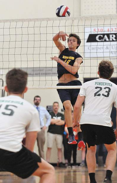 Nevada Union's Preston Nowak floats the ball over the net during the Miners three set win over the Ponderosa Bruins.