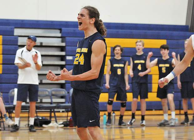 Nevada Union volleyball team captain Nick Ashbaugh reacts after the team scores a point against the Ponderosa Bruins during Thursday night's playoff win.
