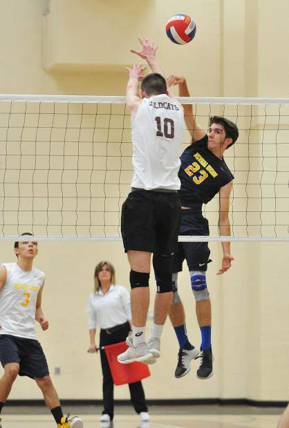 Nevada Union High School junior Jordan Mills gets the ball over the net to score a point over the Whitney Wildcats. Despite Mills' and the rest of his teammate's efforts, the Miners fell to the Wildcats in four sets.