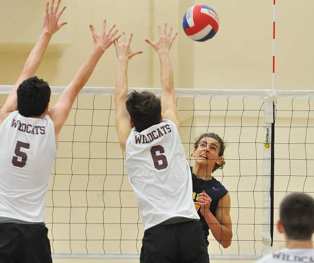 Nevada Union boys volleyball's Nick Ashbaugh gets the ball past a pair of Whitney defenders during Tuesday's semi-final playoff loss to the Wildcats.