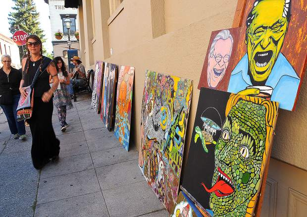 First Friday art walkers stroll down Pine Street in downtown Nevada City where local artist Nakia Johnson has his art on display alongside dozens of other artists. Two more art walks are planned for July 6th and August 3rd.