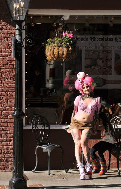 Liberty Rangel takes a break in her body painting session to show off in front of the Nevada City Chocolate Shoppe during Friday's art walk.