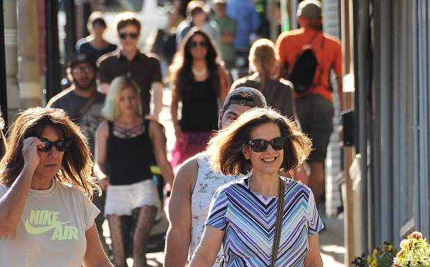 The sidewalks of Broad Street in downtown Nevada City were full of pedestrians during the first of three First Friday Art Walks hosted by the Nevada City Chamber of Commerce.