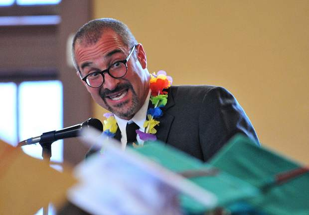 Bitney Prep English teacher Daniel Elkin gives the faculty address during Friday evening's commencement ceremony.