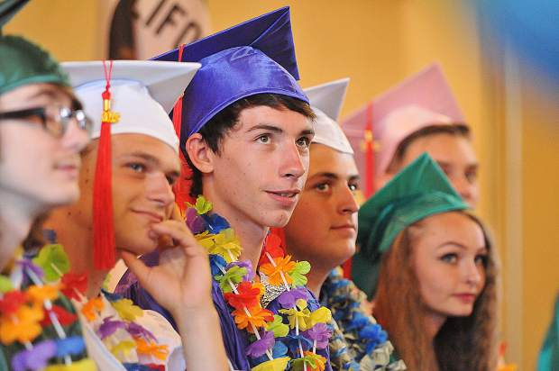 Bitney Prep High School's Uriah Beltz listens to the faculty addresses along side his fellow classmates during the class of 2018 Commencement Exercises held at the Grass Valley Elks Lodge.