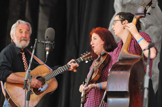 Members of the band Thompsonia (from left) Eric and Suzy Thompson, along with bassist Allegra Thompson take the main stage Saturday during the Father's Day Bluegrass Festival at the Nevada County Fairgrounds.