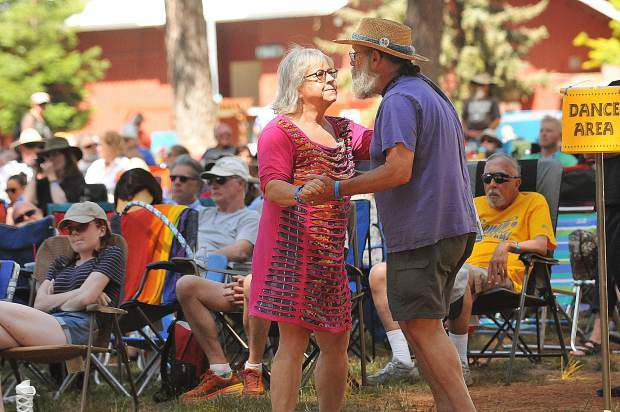 A couple dances to the tunes of one of over a dozen bluegrass bands Saturday at the annual Father's Day Bluegrass Festival at the Nevada County Fairgrounds.