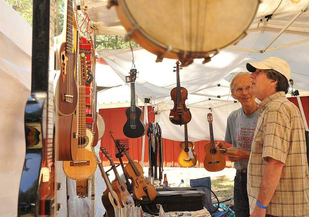 It was a banjo player's paradise at the Nevada County Fairgrounds where bluegrass instruments including fiddles, violins and guitars were offered for sale by many vendors.