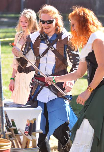 Smartsville's Josh Danckert inspects a wooden sword, one of the many types of items made available by Celtic vendors at the Celtic Festival.