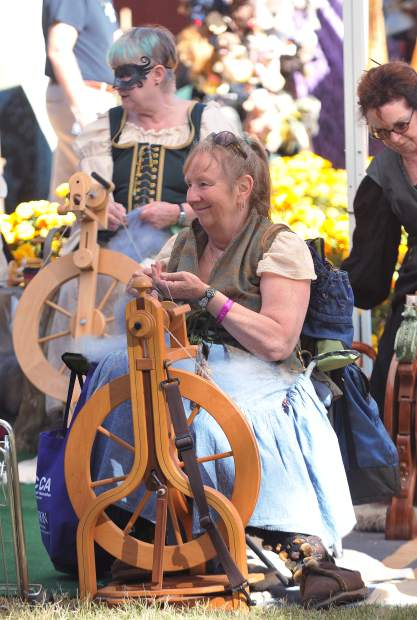 Grass Valley's Alice Bechtolb works on spinning wool along with others during the Celtic Festival.