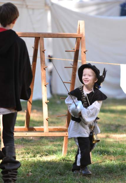 Drake and Elias Atkinson (right) work their hand at fencing before taking part in one of the many different judged competitions