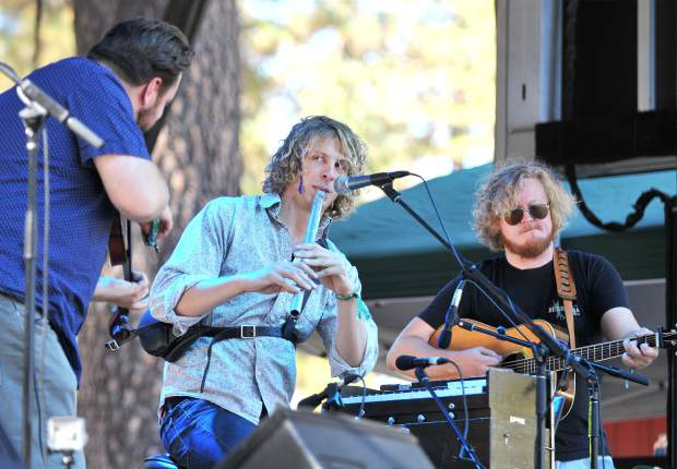 MAC members Ryan McKasson, Elias Alexander and Colin Cotter perform on stage Saturday to the delight of festival attendees.