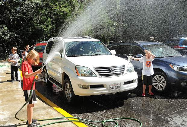 With a motto of giving back to the community, Deer Creek Elementary School fourth-graders chose to wash the 44 vehicles of the school's staff during the last day of school Friday afternoon.
