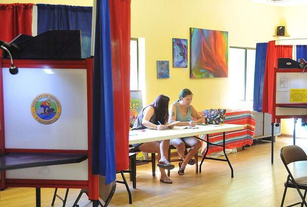 A pair of voters work on their ballots together during a lull in the voting Tuesday afternoon at the North San Juan Community Center's voting location.