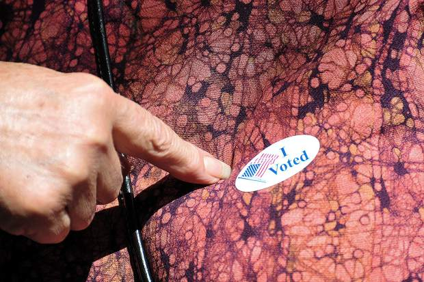 A Nevada County voter points to her 'I Voted' sticker Tuesday in North San Juan.