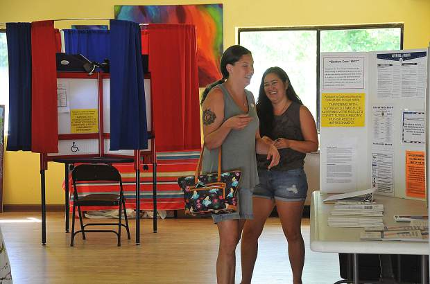 North San Juan's Jalen Osinski and Tia Nii smile as they leave the North San Juan Community Center's voting location after voting Tuesday afternoon.