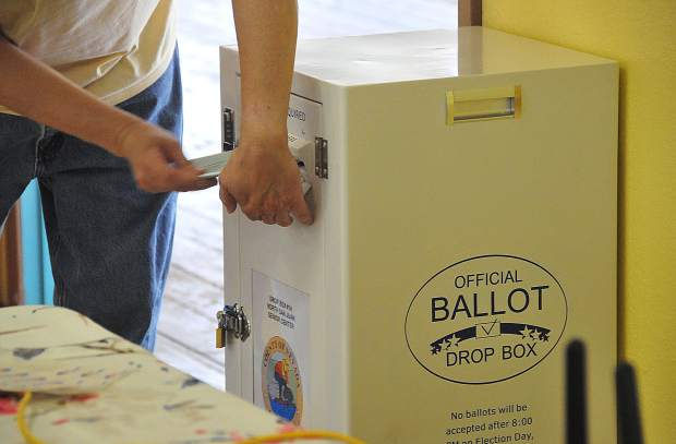 A voter drops his ballot into an official Nevada County ballot drop box Tuesday afternoon at the North San Juan Community Center's voting location.