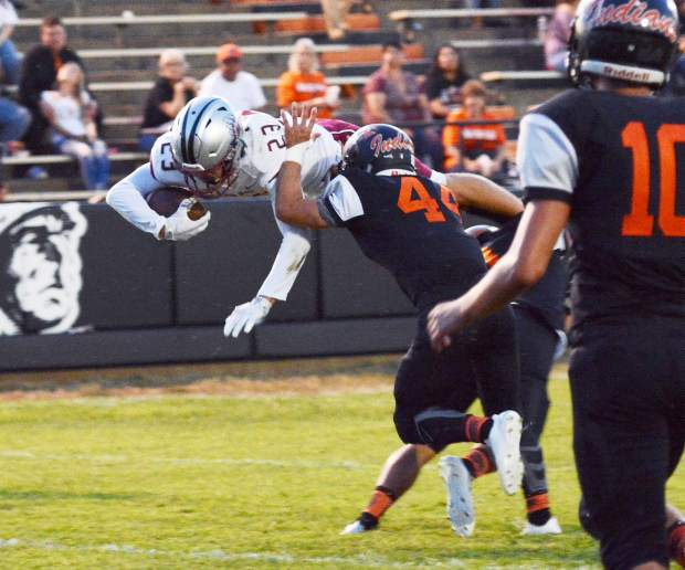 Bear River's Calder Kunde takes flight as he fights for extra yards during a game against Marysville Friday. The Bruins topped the Indians 46-7, and improved to 4-0 this season.