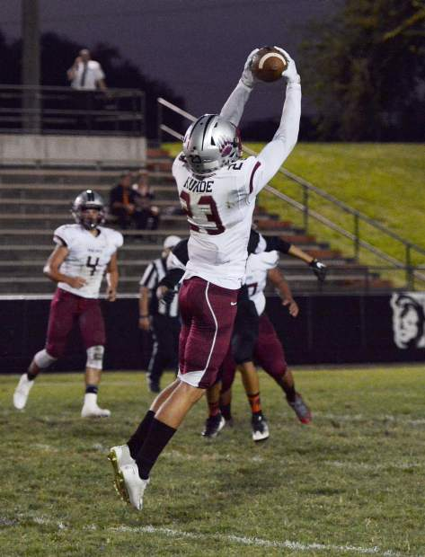 Bear River's Calder Kunde pulls down a pass during a game against Marysville last Friday. Kunde has shown he can score points for his team in several different ways this season, throwing for two touchdowns, catching a touchdown pass, running one in and taking an interception back for a touchdown as well.