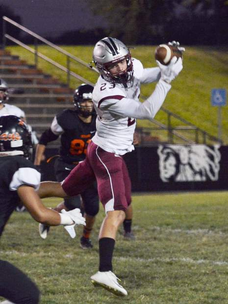 Bear River's Calder Kunde pulls down a pass during a game against Marysville Friday. The Bruins topped the Indians 46-7, and improved to 4-0 this season.